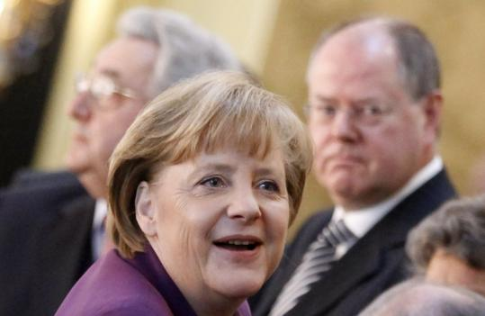 Merkel also underlined her resistance to growing calls for a major bond-buying campaign by the European Central Bank.