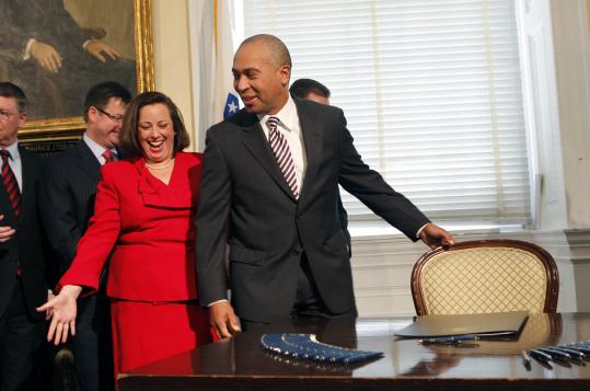 Representative Kathi-Anne Reinstein welcomed Governor Deval Patrick to sit down and sign the council bill in the governor's council chambers in Boston. The decision has alienated some of his earliest supporters.