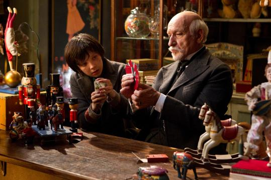 "Ben Kingsley (with Asa Butterfield) plays Georges in Martin Scorsese's ""Hugo.''"