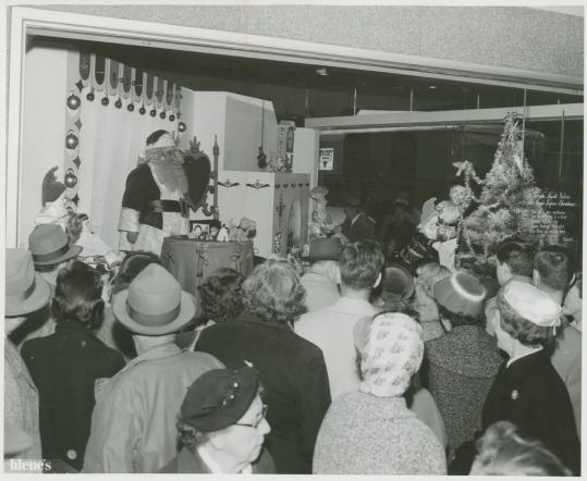 Filene's Basement was packed with patrons who squeezed in to take a look at a Santa Claus during a holiday season in the 1920s.