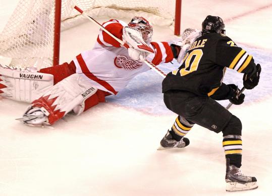 Bruins left wing Daniel Paille beats sprawling Red Wings goalie Jimmy Howard to tie the game at 1 in the second period.