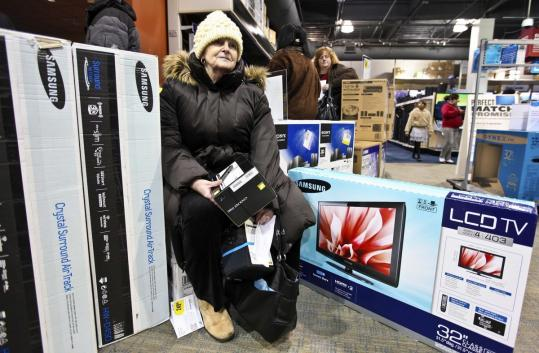 Cathy Quinn waited in line at the CambridgeSide Galleria Best Buy. She is keeping a close eye on expenses this year.