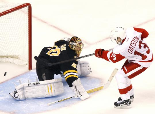 Slick Pavel Datsyuk helps the Red Wings draw first blood against Bruins goalie Tuukka Rask in the shootout.