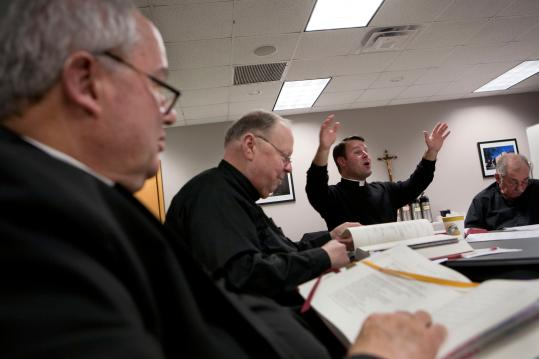 The Rev. Jonathan Gaspar of the Boston Archdiocese taught priests about changes to the Catholic Mass.