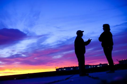 """""""Red sky in the morning means there's a storm coming,'' says Vickie DeRosa (right), the fish pier's property manager."""