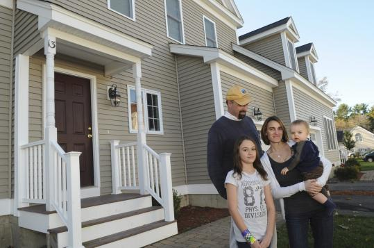 Jeff and Lisa Spencer, with their children, Emily and Will, purchased their town house at Ipswich River Point three years ago as affordable housing.