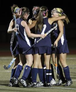 Andover players celebrate the first goal in the Division 1 EMass field hockey final.