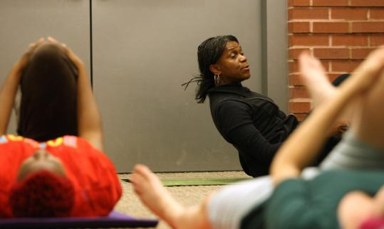 Yoga instructor Anna Dunwell teaching a class for people with low-back pain at the Boston Medical Center complex.