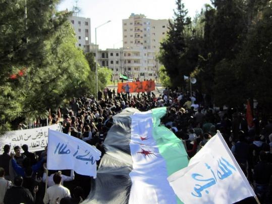Demonstrators marched against President Bashar Assad in yesterday Deir Belaba, Syria. Syria refused to admit Arab civilian and military observers to oversee a peace agreement.