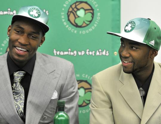 Rookies JaJuan Johnson (above, left) and E&#8217;Twaun Moore will have to learn on the fly, while Danny Ainge (below, left with Avery Bradley) will have to hustle to secure free agents.