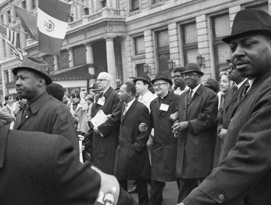 "Center (from left): Dr. Benjamin Spock, Martin Luther King Jr., Monsignor Charles Rice, and Cleveland Robinson march arm in arm during an antiwar demonstration in New York on April 17, 1967. Henry Louis Gates Jr. (below) chronicles the black experience in America through photographs and short essays about events, trends, and individuals in ""Life Upon These Shores.''"