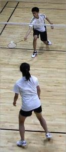 On a recent day at the Boston Badminton Club in Westborough, Phyllis Lin of Acton volleyed with Alex Chung of Westford.