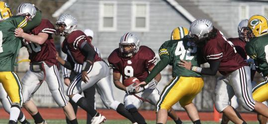 TURKEY DAY TROT: Lynn English's P.J. Dorsey (9) has plenty of blocking during the annual Thanksgiving Day game between Lynn Classical and Lynn English at Manning Field in Lynn. English beat Classical 35-0.