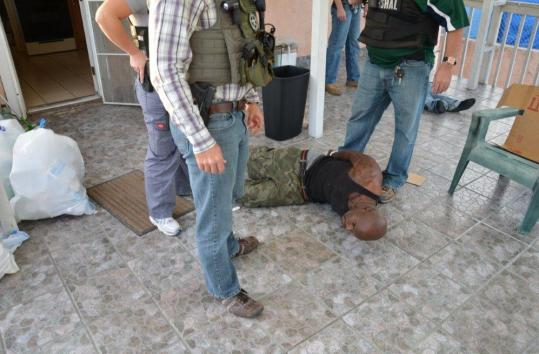 Arthur Morgan III was surrounded by marshals as he was arrested Tuesday in San Diego, having fled cross-country.