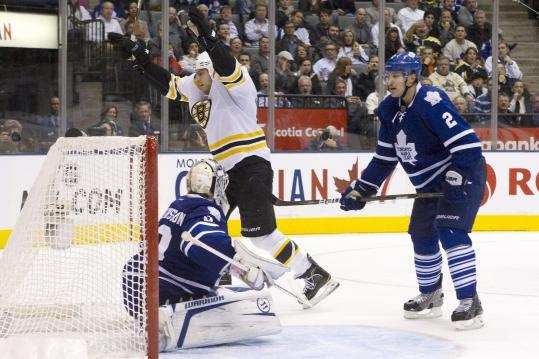 Milan Lucic celebrates his second goal after slamming a pretty feed from David Krejci past Maple Leafs goalie Jonas Gustavsson.