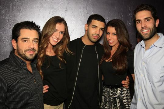 From left: club owner George Aboujaoude with Kathryn Hamilton, Drake, Marcy Sawa, and Walid Samaha hanging out at Bijou.