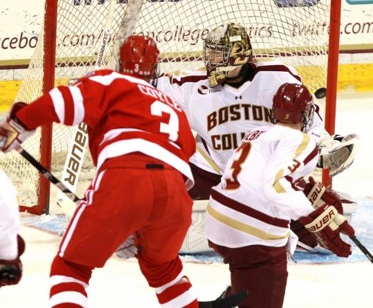 Charlie Coyle (3) gets BC goalie Parker Milner to go one way as he shoots the puck the other way.