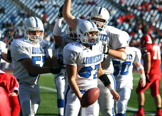 Daniel Curley (87) had a ball with his teammates after he scored in the second quarter to give Leominster a 12-0 lead.