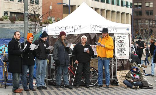 "The Davis Square Carolers sang some not-so-traditional Christmas songs in Dewey Square in Boston, including ""The Twelve Days of Crisis.''"
