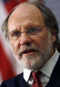 Regulators are investigating whether MF Global, under Jon Corzine, illegally tapped clients' accounts.