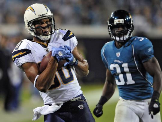Chargers' Malcom Floyd pulls in a 52-yard TD reception in front of Ashton Youboty.