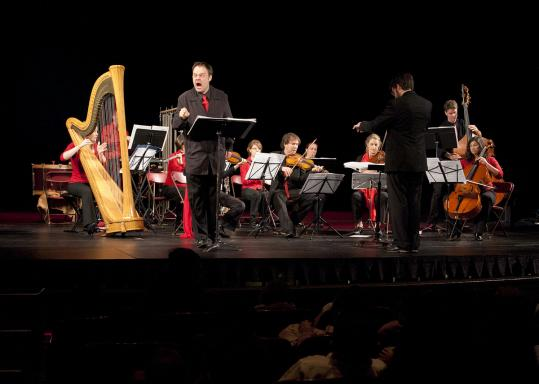 Baritone Aaron Engebreth and conductor Jeffrey Means with the Firebird Ensemble on Monday at the Strand Theatre.