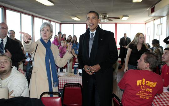 President Obama and Health and Human Services Secretary Kathleen Sebelius visited We B Smokin' restaurant in Kansas.