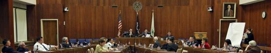 Everett will do away with its 18-member Common Council and seven-member Board of Aldermen, shown together in session, in favor of an 11-member City Council starting in 2014.