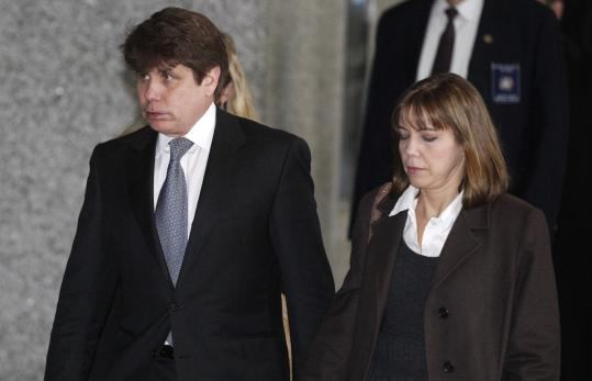 Rod Blagojevich left the federal building in Chicago with his wife, Patti, yesterday, after he was sentenced to 14 years in federal prison for 18 felony corruption convictions, including trying to sell or trade the Senate seat that President Obama vacated.