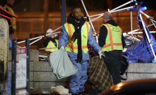 City workers removed tents and other items following an overnight police raid on the Occupy San Francisco protest site in Justin Herman Plaza.