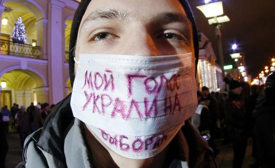 "A protester in St. Petersburg yesterday wore a sign saying, ""My vote was stolen at the election.'' Dozens of online videos claimed to record examples of fraud in parliamentary elections."