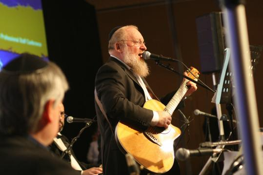 Rabbi Moshe Shur, who makes Jewish-themed folk-rock albums, combines Jewish prayers with Grateful Dead songs.