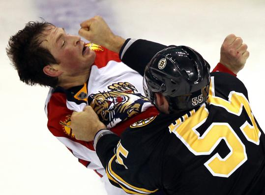 Johnny Boychuk of the Bruins engages in a spirited tussle with the Panthers' Jack Skille in the second period.