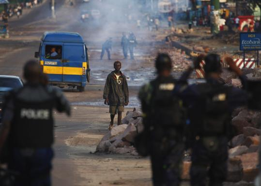 A Congolese man stared at riot police in the pro-Tshisekedi Matete commune in Kinshasa, Congo, after incumbent Joseph Kabila was declared winner of the presidential race.