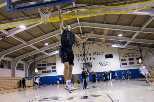 Steve Haladyna practiced with his team Wednesday evening at the St. John's Prep gymnasium.