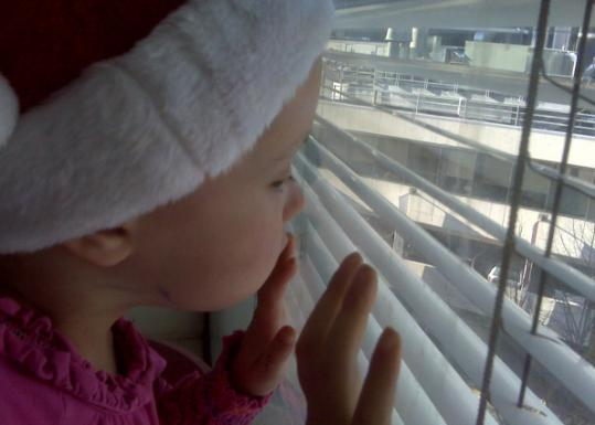 Charlotte Rose Kelly looked out a window after her cancer diagnosis.