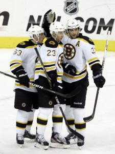 Chris Kelly (center) had some company when celebrating his insurance goal.