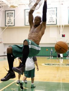Ray Allen enjoys some additional hang time by grabbing onto the rim following his dunk during practice yesterday.