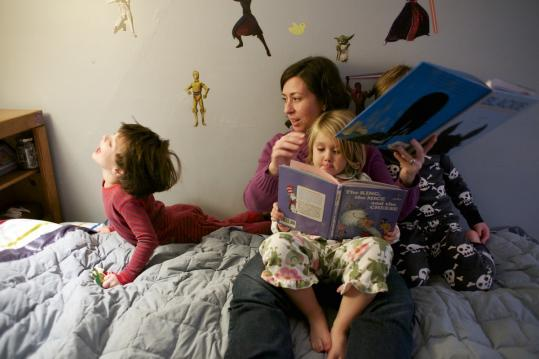 Kristin Bullard of Marblehead, a paralegal, read to her three children last week before putting them to bed.
