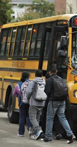 Students board school buses outside the Thomas Edison School in Brighton.