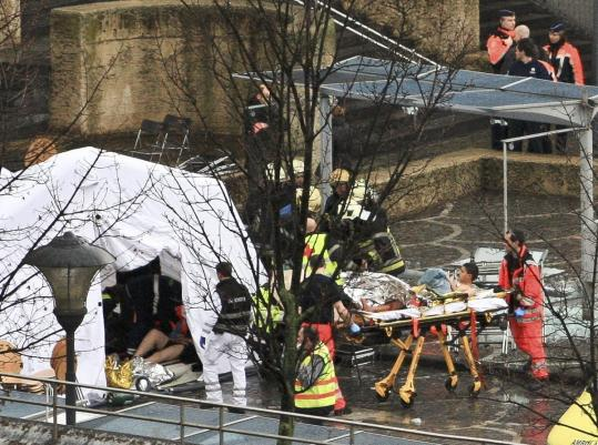 Rescuers evacuated the injured at the Place Saint Lambert square in Belgium, where a man tossed three hand grenades.