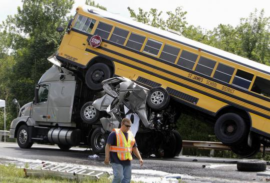 Investigators said a driver was texting when his pickup truck, two school buses, and cars collided in Missouri last year.