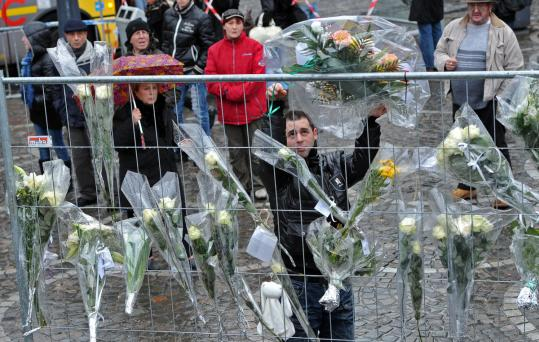 A memorial grew yesterday to victims of a weapons attack Tuesday in Liege, Belgium. A gunman apparently killed a cleaning woman prior to killing three other people in a crowded square.
