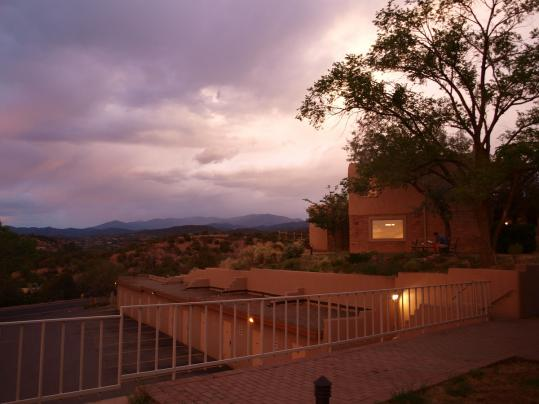 The Fort Marcy Hotel Suites overlook the Sangre de Cristo Mountains, the southernmost subrange of the Rockies. Below, local performer Annie Rose, also known as the Flower Fairy, visits with Skylar Cook, 5, at the Santa Fe Children&#8217;s Museum.