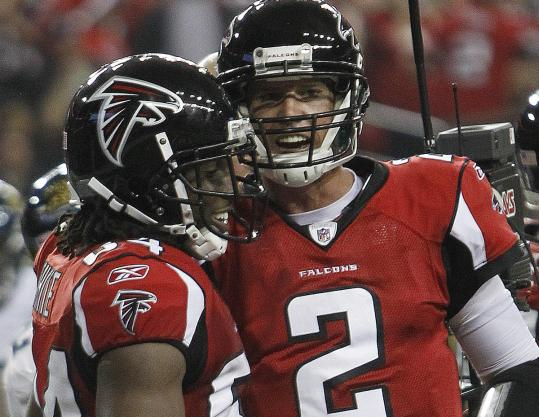 Matt Ryan (right) celebrates with receiver Roddy White after the two connected for a first-half touchdown.