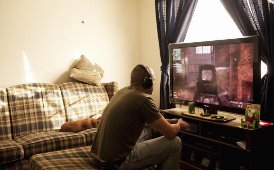 Marine Corporal Clayton Rhoden, a veteran who is struggling to find employment, played Call of Duty: Modern Warfare 3, in Columbus, Ohio. Rhoden sells his blood plasma for $80 a week.