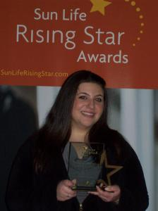 At a State House ceremony, Tayler Sabella received a $5,000 Rising Star Award that she will use toward college.