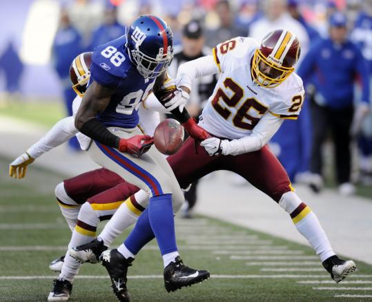Very little went right for the Giants in a lackluster effort, such as this pass to Hakeem Nicks that was broken up by the Redskins' Josh Wilson.
