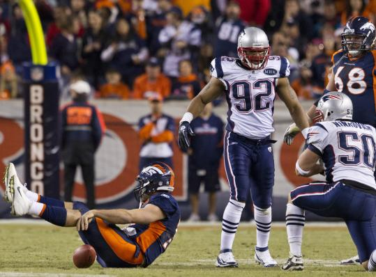 With a sack of Tim Tebow (the Patriots' fourth and final) for a loss of 28 yards, Rob Ninkovich (50) flattened the Broncos' hopes.
