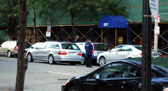 Cars were double-parked outside the Chilton Club in the Back Bay. Three agencies have at least some jurisdiction over valet parking, but no one embraces it.